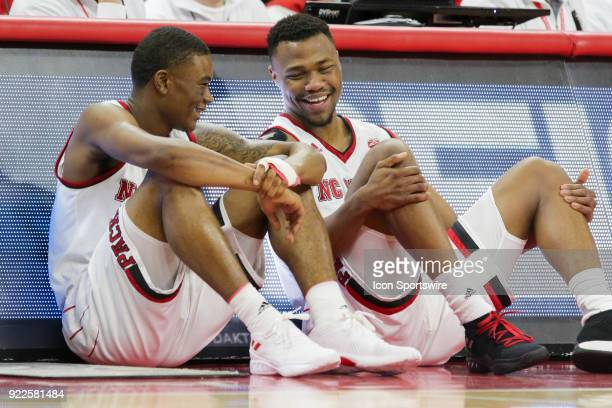 State guard Markell Johnson and guard Torin Dorn wait to go into the game between the Boston College Eagles and the NC State Wolfpack at PNC Arena on...