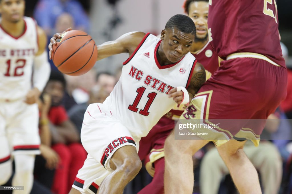 NC State guard Markell Johnson (11) drives past a defender during the game between the Boston College Eagles and the NC State Wolfpack at PNC Arena on February 20, 2018 in Raleigh, NC. The Pack won 82-66.