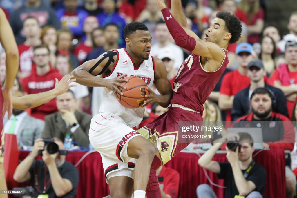 NC State guard Torin Dorn (2) is defended by Boston College guard Jerome Robinson (1) during the game between the Boston College Eagles and the NC State Wolfpack at PNC Arena on February 20, 2018 in Raleigh, NC. The Pack won 82-66.
