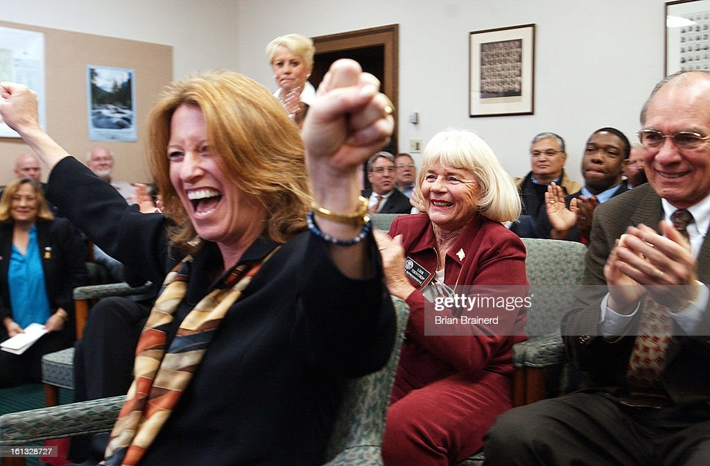 DENVER, CO, NOV 4, 2004 -- State house and senate caucuses elected leadership featuring Democrats in the majority as a result of Tuesday's election. New majority leader Alice Madden celebrates on her election to the position as Betty Boyd and Jim Riesberg : News Photo
