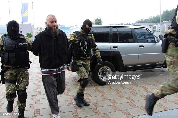 State Investigation and Protection Agency police officers take man accused of the 'financing organizing and recruitment of Bosnians to go to Syria...