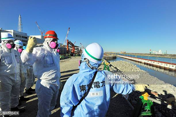 State Minister for Reconstruction Tsuyoshi Takagi asks question during his inspection at Tokyo Electric Power Co's Fukushima Daiichi Nuclear Power...