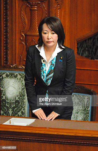 State Minister for the state secrets protection bill Masako Mori stands up after the bill was passed the Upper House on December 6 2013 in Tokyo...