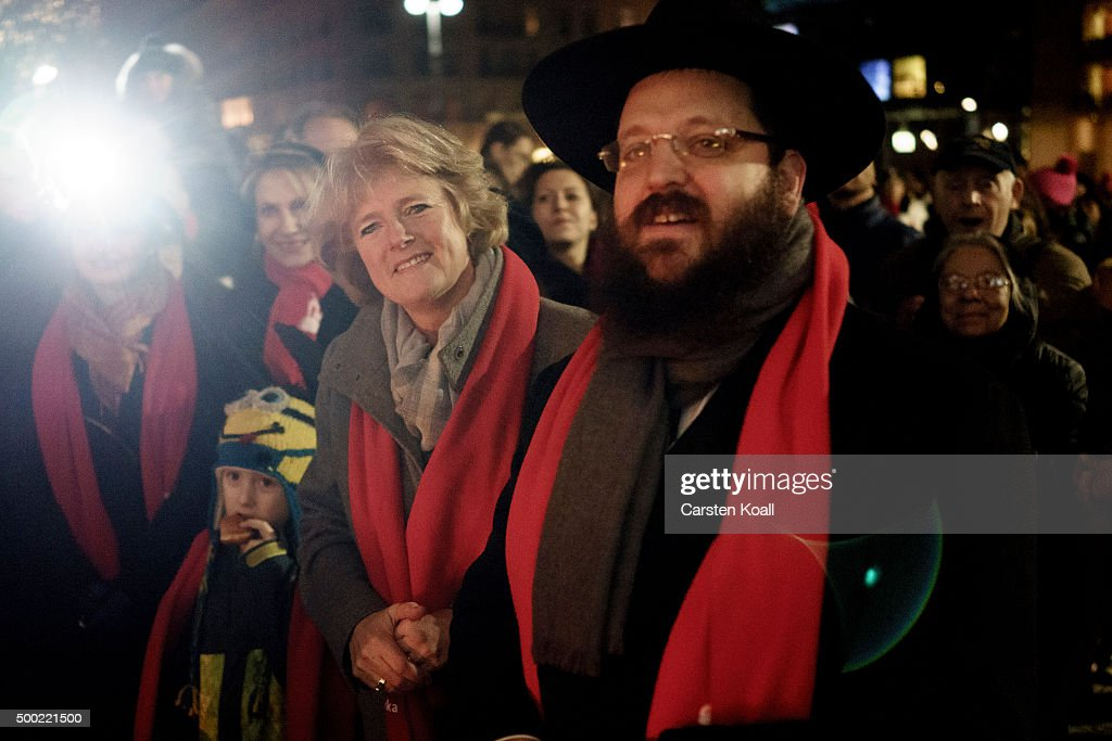 State Minister Monika Gruetters (L) and Rabbi Yehuda Teichtal (R) attend the ceremony of the Hanukkah menorah lighting at a public Menorah ceremony near the Brandenburg Gate on December 6, 2015 in Berlin, Germany. The annual events are part of a worldwide Hanukkah campaign set into motion by the Lubavitcher Rebbe Rabbi Menachem M. Schneerson, of righteous memory.