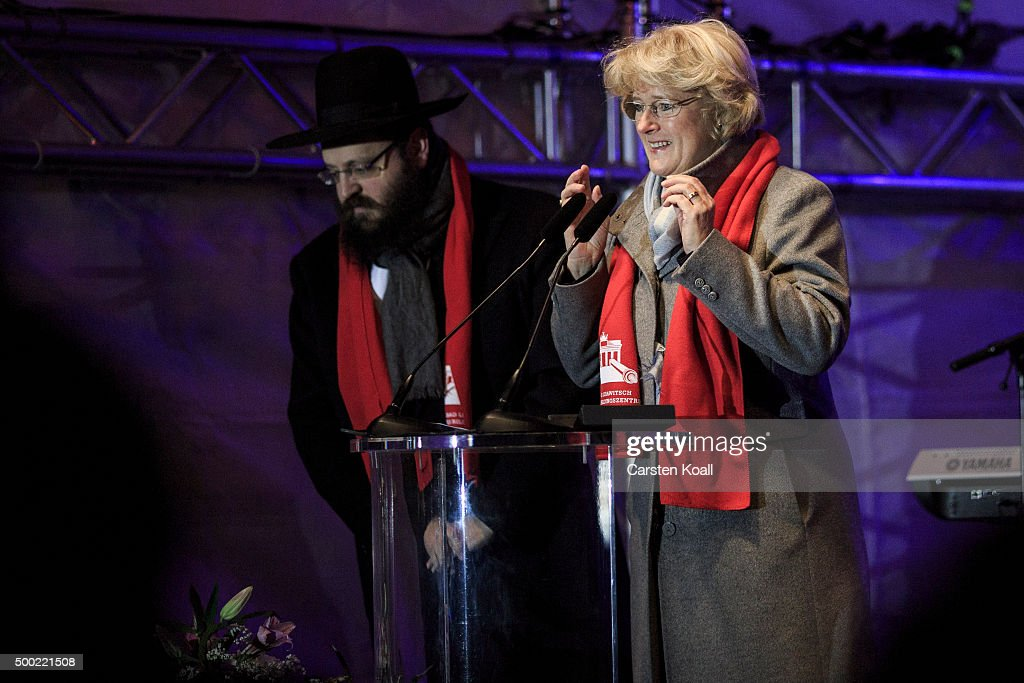 State Minister Monika Gruetters speaks beside Rabbi Yehuda Teichtal at the ceremony of the Hanukkah menorah lighting at a public Menorah ceremony near the Brandenburg Gate on December 6, 2015 in Berlin, Germany. The annual events are part of a worldwide Hanukkah campaign set into motion by the Lubavitcher Rebbe Rabbi Menachem M. Schneerson, of righteous memory.