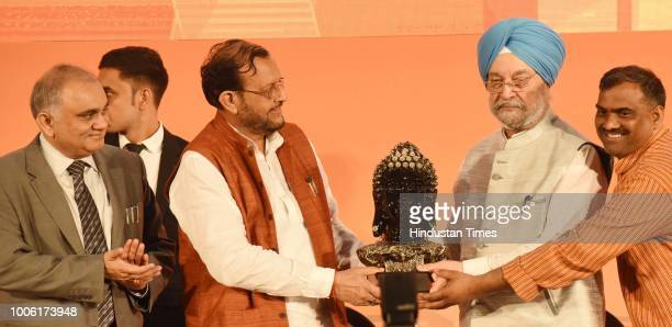 State Minister Suresh Khanna presents a memento to Hardeep Singh Minister Housing and Urban Affairs Govt of India during a function 'Transforming...