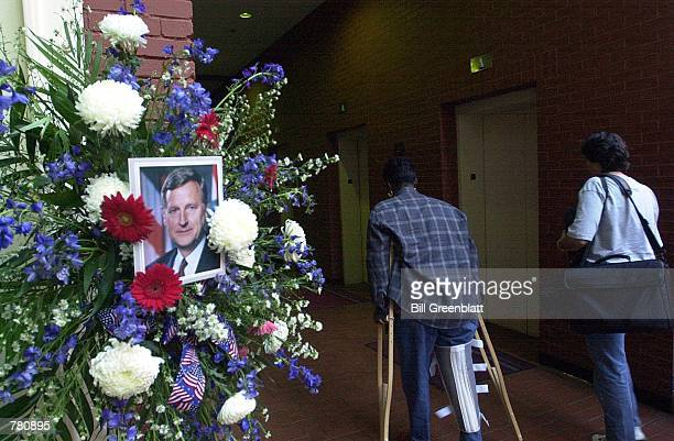 State office workers file by a memorial for the late Missouri Governor Mel Carnahan in the lobby the Wainwright State Office Building October 19 2000...