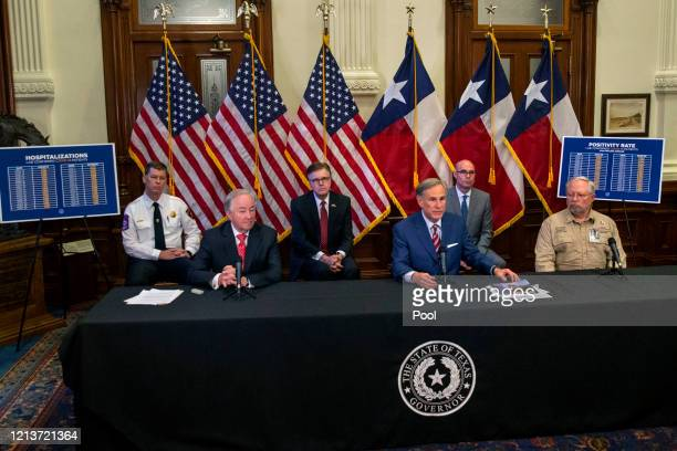 State officials surround Texas Governor Greg Abbott as he announces the reopening of more Texas businesses during the COVID19 pandemic at a press...