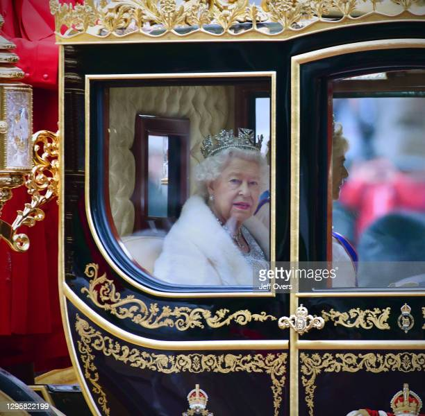 State Opening of Parliament. The carriage of Queen Elizabeth II crosses Horse Guards Parade, London, en-route to the Palace of Westminster where she...