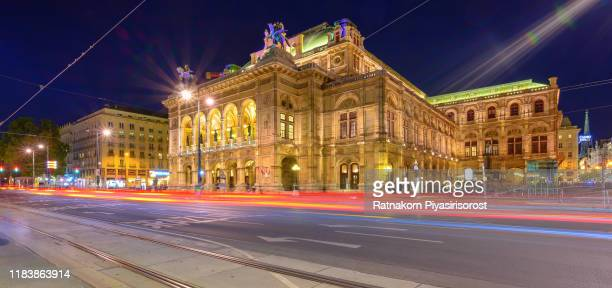 state opera at sunset scene with traffic road light - vienna, austria - vienna state opera stock pictures, royalty-free photos & images