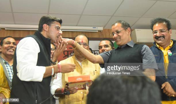 State Party president Sachin Pilot being offered sweets by leader of opposition Rameshwar Dudy and other office bearers to celebrate the victory of...