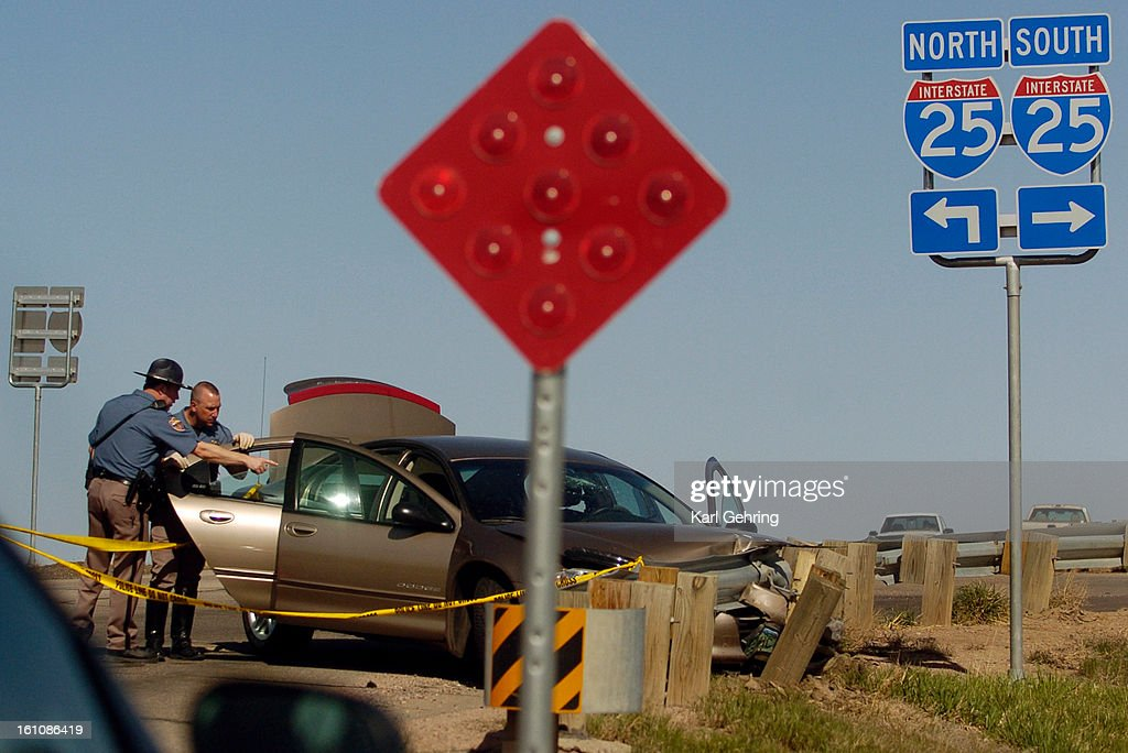 WELLINGTON, CO (04-22-2006) -- State Patrol officers examined a Dodge Intrepid Saturday afternoon after it's driver and passengers crashed into a guardrail and fled into Wellington, Colorado. The car was stolen. The vehicle was initially noticed by the St : News Photo