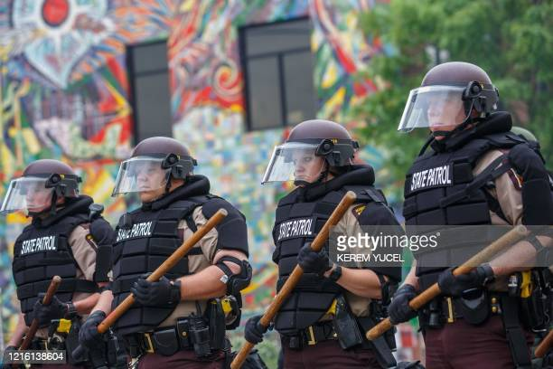 State Patrol Police officers block a road on the fourth day of protest on May 29, 2020 in Minneapolis, Minnesota. Protesters demand justice for...