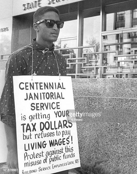 OCT 4 1961 State Picketed Wendell Jones 3725 Eudora St is one of two pickets of the Building Service Employes Local 105 who is marching in front of...