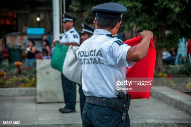 State Police folding a Mexican Flag