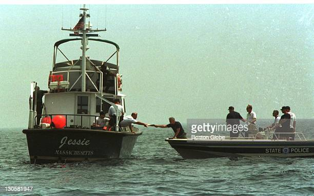 State Police hand GPS coordinates to Environmental Police for a dive site concerning the JFK Jr recovery effort approximately two miles southwest of...