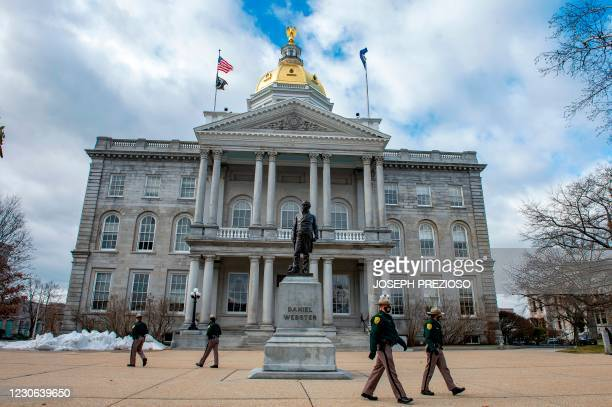 State Police patrol the State Capital in Concord, New Hampshire on January 17 during a nationwide protest called by anti-government and far-right...