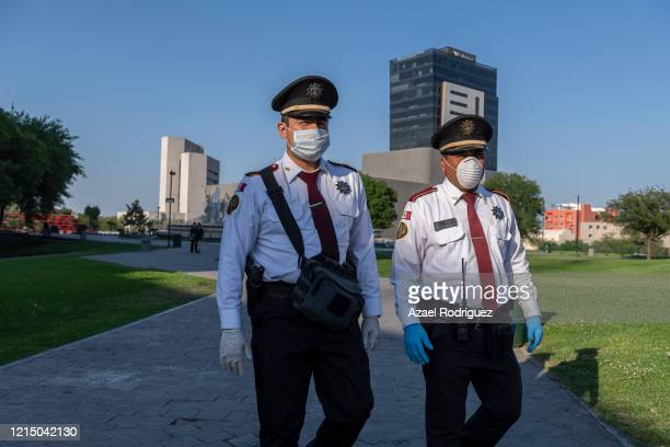 State policemen wearing masks and gloves patrol the Macroplaza on March 26 2020 in Monterrey Mexico While most countries and major cities have...