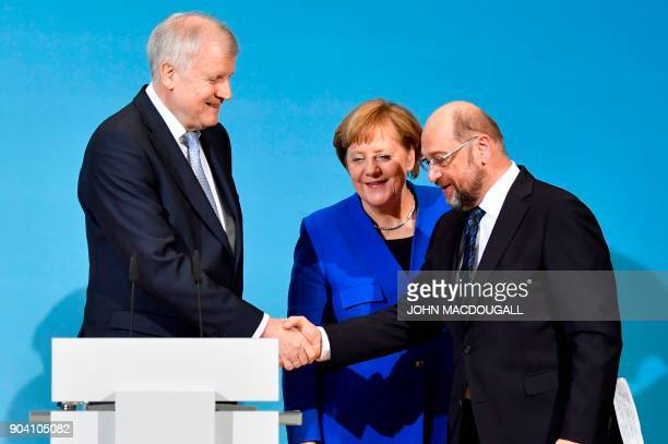 State Premier for the state of Bavaria and leader of the Christian Social Union Horst Seehofer shakes hands with the leader of the Social Democratic...