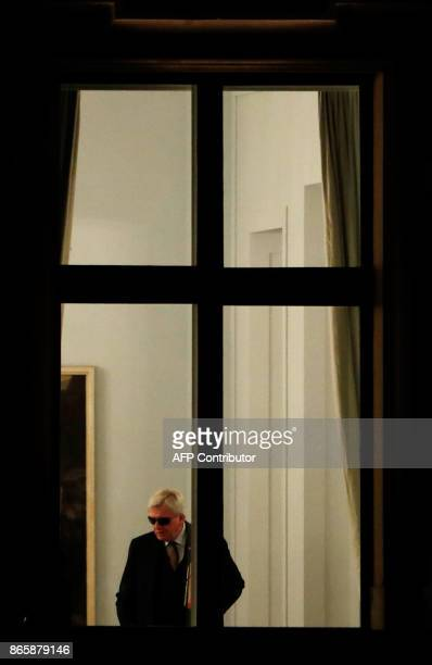 State Premier for the state of Hesse, CDU's Volker Bouffier arrives for exploratory talks in a bid to form a new government in Berlin on October 24,...