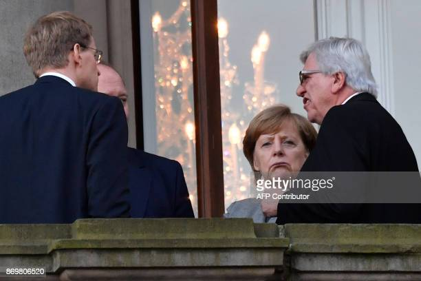 State Premier for the state of Hesse CDU's Volker Bouffier German Chancellor Angela Merkel Christian Democratic Union party's state Minister at the...