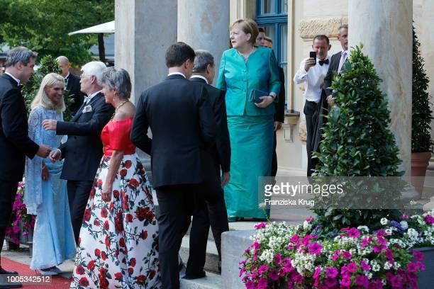 State Premier Markus Soeder, his wife Karin Baumueller, Mayor of Bayreuth Brigitte Merk-Erbe , her husband Thomas Erbe and German Chancellor Angela...