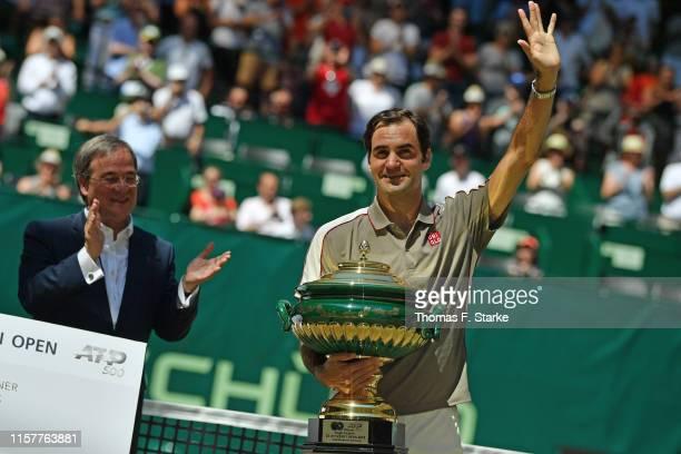 State Premier of North Rhine-Westphalia Armin Laschet applauds Roger Federer of Switzerland after winning the final match against David Goffin of...