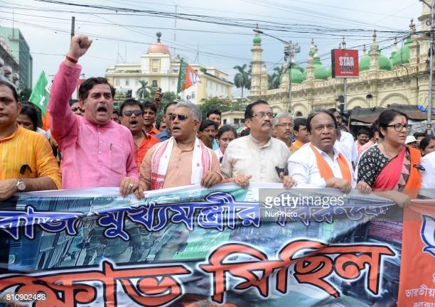 BJP State President Dilip Ghosh and other leaders held a protest rally against the act of state government and demanding Presidential rule 356 in...