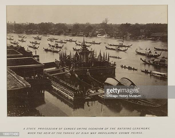 A state procession of canoes on the occasion of the bathing ceremony when the heir of the throne of Siam was proclaimed crown prince from a...