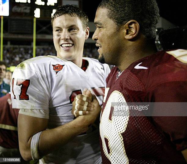 NC State QB Philip Rivers shakes hands with FSU's Michael Boulware after the FSU victory at Doak Stadium in Tallahassee Florida on November 15th 2003...