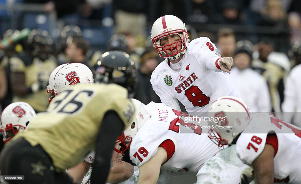N.C. State quarterback Mike Glennon (8) directs his offense during the second half of the Franklin American Mortgage Music City Bowl at LP Field in Nashville, Tennessee, Monday, December 31, 2012. The Vanderbilt Commodores defeated the N.C. State Wolfpack, 38-24.