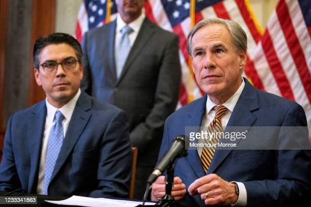 State Rep. Chris Paddie listens as Texas Governor Greg Abbott speaks at a press conference where Abbott signed Senate Bills 2 and 3 at the Capitol on...