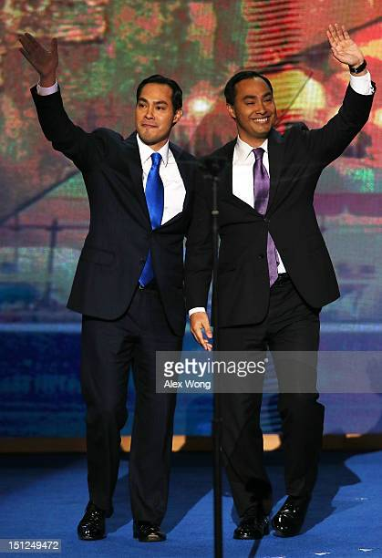 State Rep Joaquin Castro waves with his brother San Antonio Mayor Julian Castro during day one of the Democratic National Convention at Time Warner...