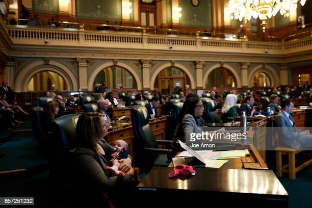 State representative Jessie Danielson and her daughter Isabelle Kabza listening as lawmakers were called back to the Capitol for a legislative...