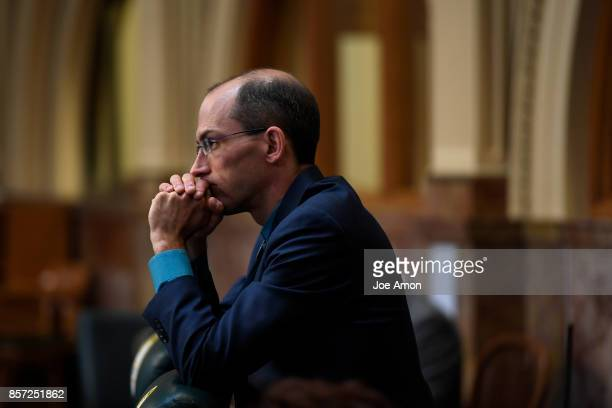 State representative Mike Weissman listening to speakers as lawmakers were called back to the Capitol for a legislative special session to fix a...