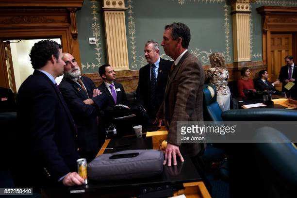 State Representatives Justin Everett Yeulin Willett Jon Becker and Paul Lundeen talking in the House as lawmakers were called back to the Capitol for...