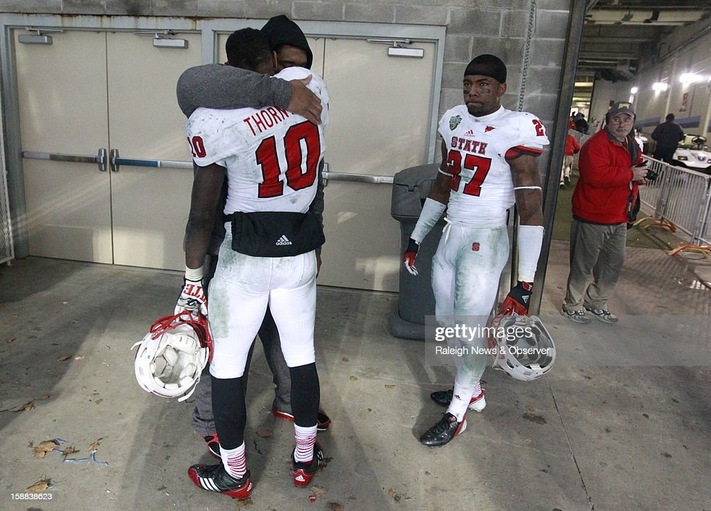 N.C. State running back Shadrach Thornton (10) hugs guard Zach Allen after N.C. State's 38-24 loss to Vanderbilt in the Franklin American Mortgage Music City Bowl at LP Field in Nashville, Tennessee, Monday, December 31, 2012.