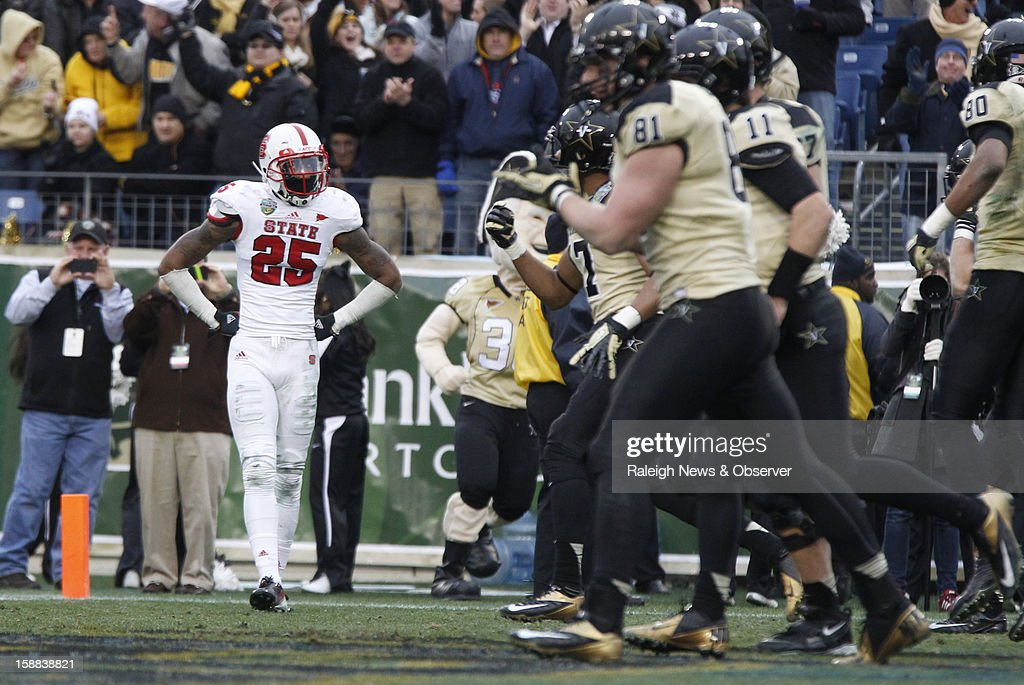 N.C. State safety Dontae Johnson (25) watches as Vanderbilt celebrates after Vanderbilt quarterback Jordan Rodgers ran in for a 15-yard touchdown during the second half of the Franklin American Mortgage Music City Bowl at LP Field in Nashville, Tennessee, Monday, December 31, 2012. The Vanderbilt Commodores defeated the N.C. State Wolfpack, 38-24.