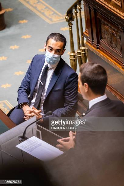 State Secretary for Asylum and Migration policy Sammy Mahdi and Independent member of Vlaams Belang chamber group, Dries Van Langenhove pictured...