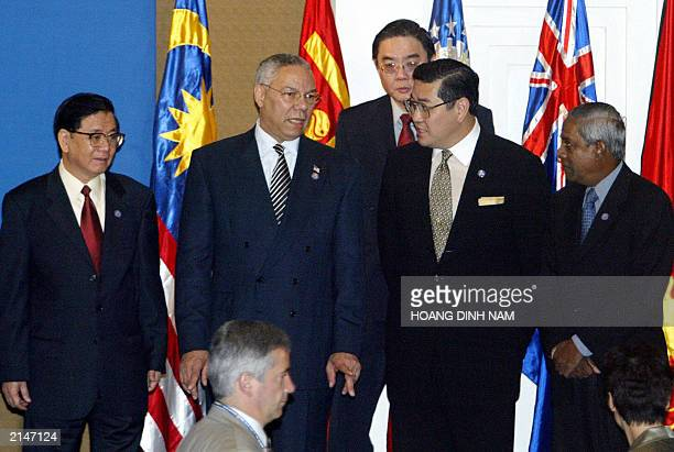 US State Secretary of State Colin Powell chats with his counterparts from Thailand Surakiart Sathirathai Vietnam's Nguyen Dy Nien Singapore's S...