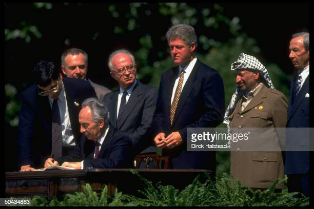 State Secy. Christopher, PLO chmn. Arafat, Pres. Clinton Israeli PM Rabin, PM Peres & Russia's Kozyrev at Israel/PLO peace accord WH signing.