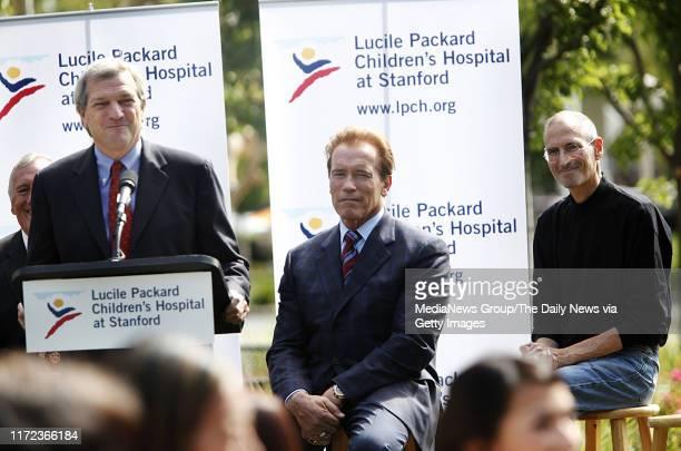 State Sen Mark DeSaulnier DConcord gives a speech next to California Gov Arnold Schwarzenegger and Apple cofounder and CEO Steve Jobs during a...