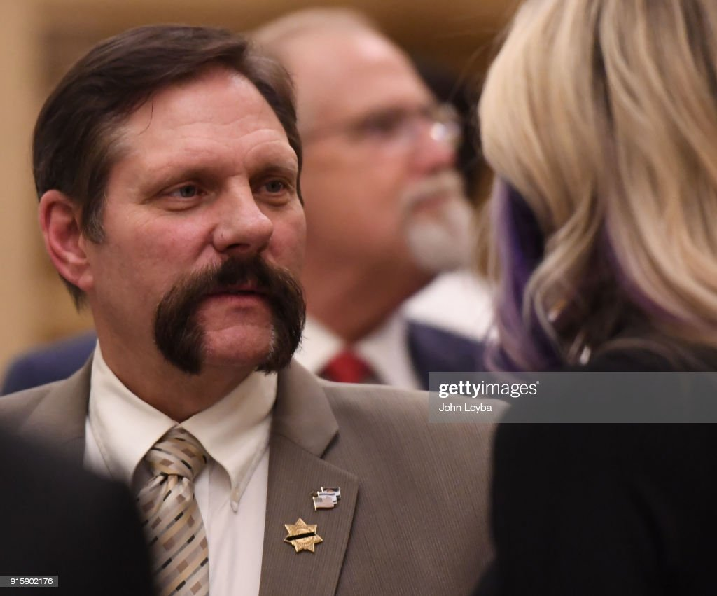 State Sen. Randy Baumgardner, a Republican from Hot Sulphur Springs, has been formally accused of sexual harassment. Senate Democrats on Thursday demanded his resignation. Baumgardner talks with Velma Donahue, the widow of State Trooper Cody Donahue on February 8, 2018 at the State Capitol.