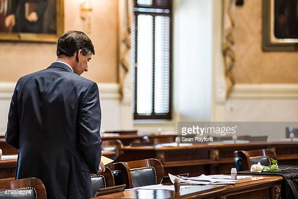 State Sen Vincent Sheehen looks at notes near the desk of Sen Clementa Pinckney in the Senate chambers July 7 2015 in Columbia South Carolina...