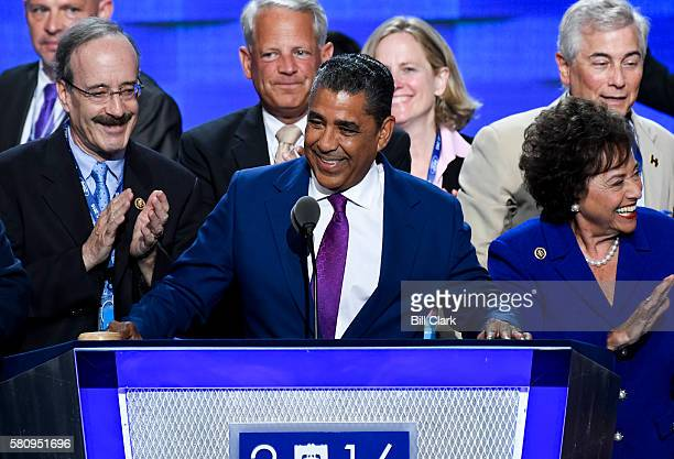 NY state senator Adriano Espaillat DNY surrounded by New York Democrat lawmakers speaks at the Democratic National Convention in Philadelphia on...