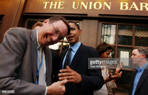 State Senator Barrack Obama DIll cracks up Paul Green of WGN Radio in Chicago at the Illinois Delegation party at Ye Old Union Oyster in Boston on...