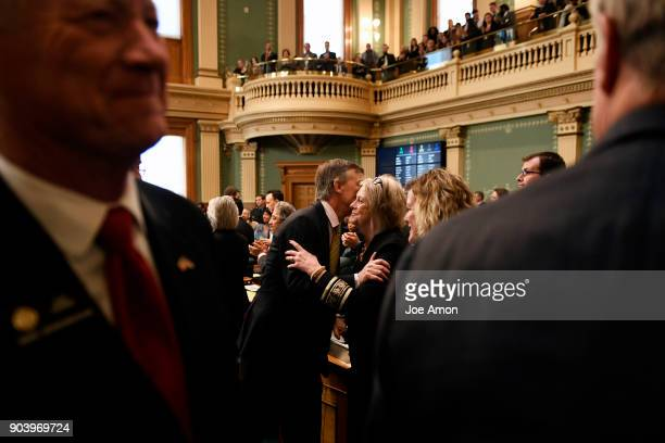 State Senator Cheri Jahn gets a hug and a kiss from Governor John Hickenlooper after delivering his last Colorado State of the State address at the...