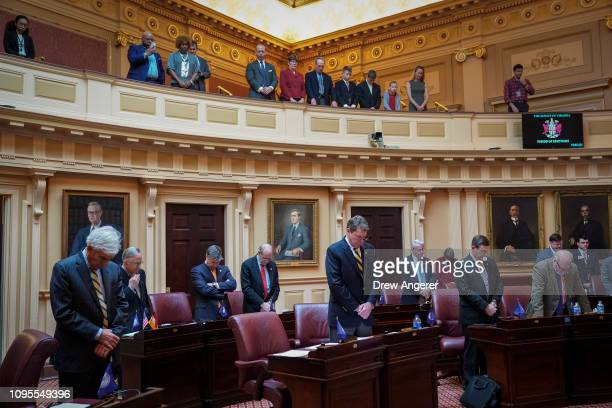 State Senators and members of the gallery stands for prayer at the start of a Senate session at the Virginia State Capitol February 8 2019 in...