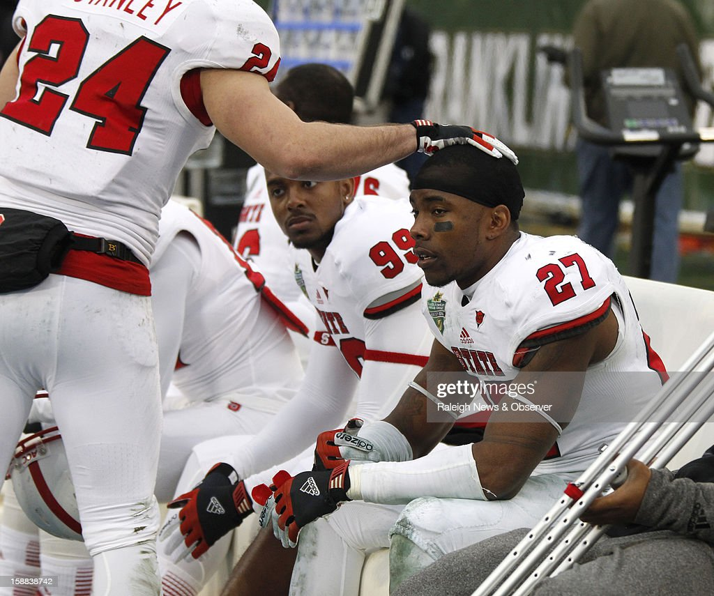 N.C. State senior safety Earl Wolff sits on the bench late in the second half of the Franklin American Mortgage Music City Bowl at LP Field in Nashville, Tennessee, Monday, December 31, 2012. The Vanderbilt Commodores defeated the N.C. State Wolfpack, 38-24.