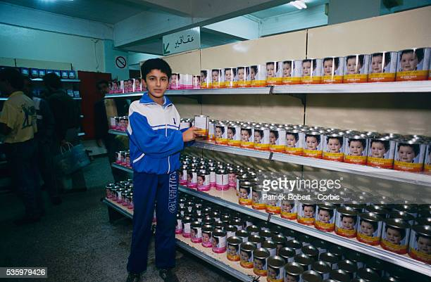 State store shelves are restocked after riots broke out in Algiers instigated by rising food prices in a country with an unemployment rate of more...